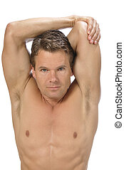 Triceps stretch - Muscular athletic shirtless man performing...