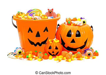Group of Halloween Jack o Lantern candy holders and pile of candies