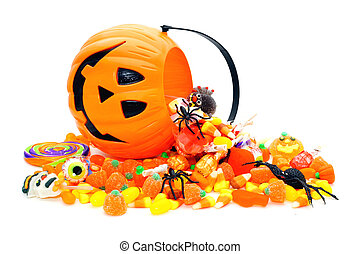 Trick or Treat - Halloween candy spilling from a Jack o ...