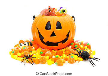 Halloween Jack o Lantern pail with pile of candy over white