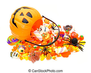 Halloween Jack o Lantern pail with spilling candy on white