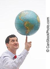 tricky - man balancing the world on one finger - Ein Mann...