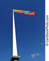 Tricolor Lithuania flag in front of blue sky. Concept of proud and freedom