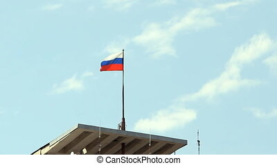 Tricolor Russian flag fluttering in the wind