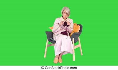 tricot, dame, key., vert, chroma, écran, vieux, intelligent, séance, chaise