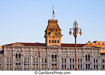 Trieste, Italy - Unity of Italy Square, detail of City Hall with tower clock at sunset