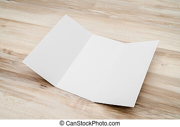 Trifold white template paper on wood texture - Trifold white...