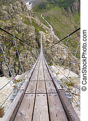 Trift Bridge is the longest pedestrian-only suspension bridge in the Alps, totaling 170 metres (560 ft) in length and traversing a height of 100 metres (330 ft). The bridge spans the lake, Triftsee, near Gadmen, Switzerland