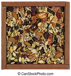 tril mix with nuts, berries and seeds in a wooden box