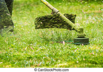 trimmer head cutting grass to small pieces - close up shot...