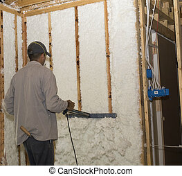 Trimming the Insulation - Worker trimming the wall...