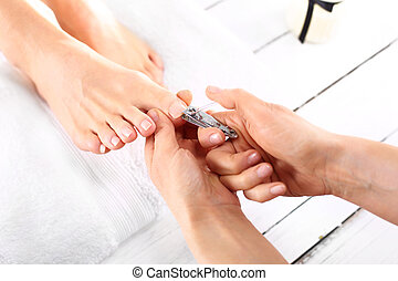 Trimming toenails, woman on pedicur - Foot care treatment ...