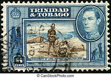 TRINIDAD AND TOBAGO - CIRCA 1945: A stamp printed in Trinidad and Tobago dedicaded Discovery of Lake Asphalt by Raleigh, 1595, circa 1945