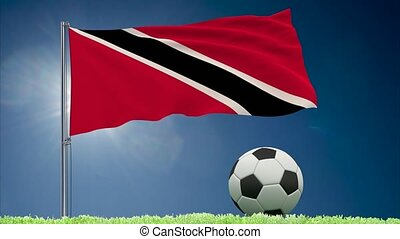 Trinidad and Tobago flag fluttering and football rolls -...