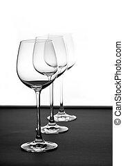 three wine glasses in black and white