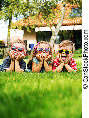 Trio kids showing their tongues - Trio children showing...