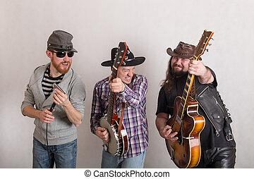 trio of cheerful musicians