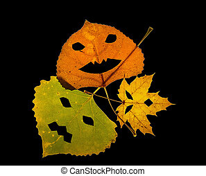 Trio of colorful Jack-O-Lantern Leaves on Black Background