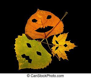 Trio of colorful Jack-O-Lantern Leaves on Black Background