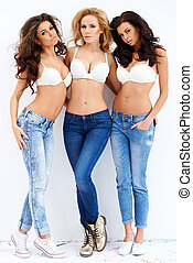 Trio of sexy shapely women in jeans and bras - Trio of sexy...