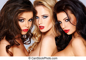Trio of sexy tantalising young women