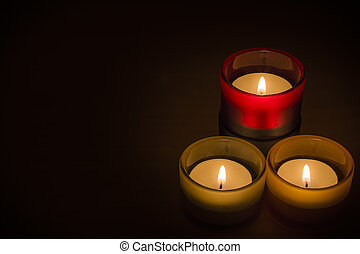 Trio of tea-lights with text space