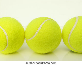 trio of tennis balls - three tennis balls in a row
