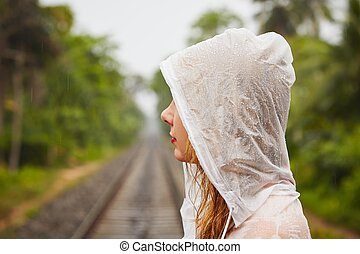 Trip in heavy rain - Young woman on the trip in heavy rain