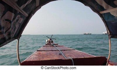 Trip on a motorized boat. Inside view