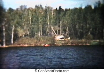 A family takes a trip out to the lake in their 57 Ford and then drives a speed boat around Lake of the Woods in Ontario, Canada. (Scan from archival 8mm film)