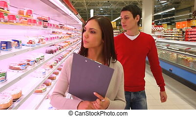 Trip to the store - Determined young woman and her boyfriend...