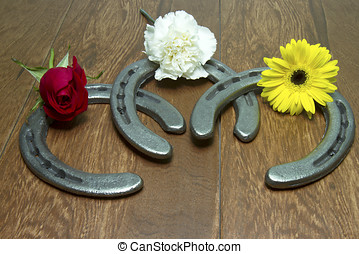 Triple Crown Flowers on Horseshoes - Three flowers of the...