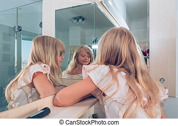 triple reflection of child in the mirror