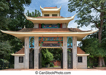 Triple roofed gate with colorful decorations mark the entrance to the Japanese Garden in Bangalore.