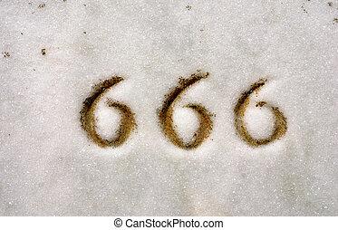 Triple Sixes 666 - Macro of numbers 666 engraved on granite...