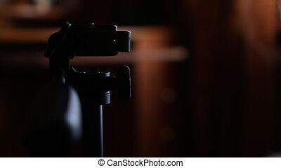 Tripod for camera. Three-legged tripod. Screwing for camera. Camera control pen