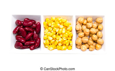 Tris of cooked vegetables on a white background seen from above