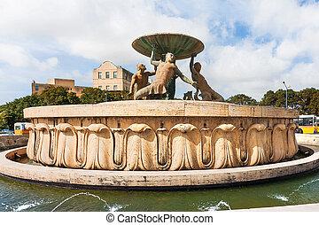 Triton Fountain in the City Gate Square of Valletta. ...