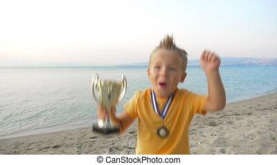 Triumph of small winner - Slow motion of a little boy...