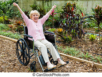 Triumph Over Adversity - Beautiful senior lady in wheelchair...