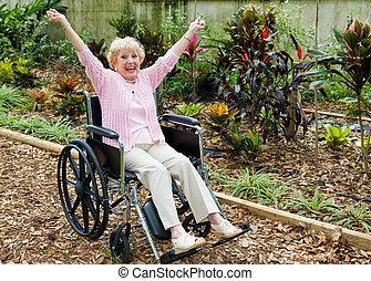 Triumph Over Adversity - Beautiful senior lady in wheelchair...