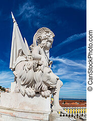 Statue on triumphal augusta arch in Lisbon in a beautiful summer day