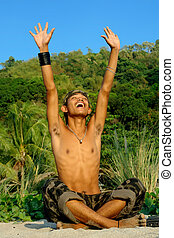 Triumphant Asian soldier in jungle - Asian young soldier or...