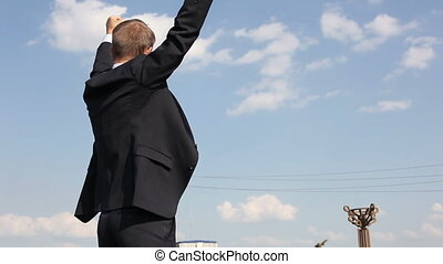 Triumphant businessman - Young entrepreneur being excited...