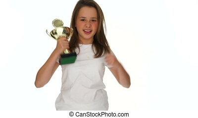 Triumphant jubilant young schoolgirl with a trophy -...