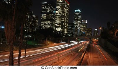 This is a downtown Los Angeles freeway timelapse shot. Cool blur of lights.