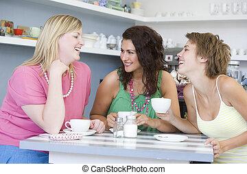 trois, jeune femme, séance table, et, thé buvant