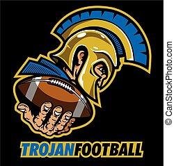 trojan football mascot holding ball in hand for school,...
