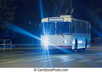 trolleybus goes at night down street - trolleybus goes on ...