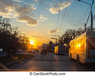 trolleybus on street - Trolleybus on street road with sunset...